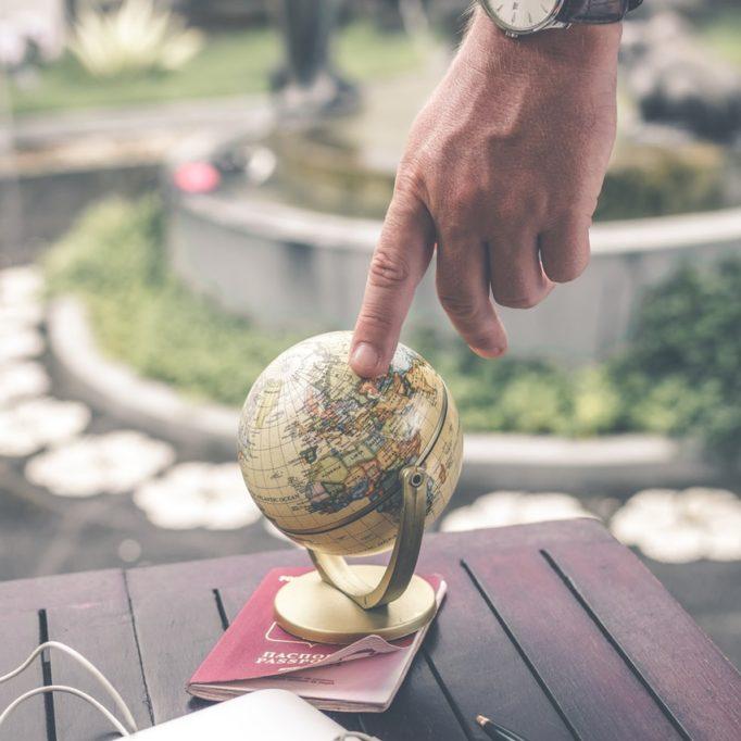 person-holding-globe